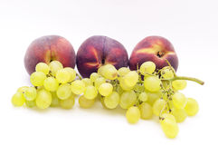 Grape and peach Stock Images
