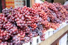 Fresh ripe grape store on the basket for sell at On Nut, Bangkok, Thailand. Grape is plant in Thailand in region that has cold weather such as northeastern or Royalty Free Stock Image