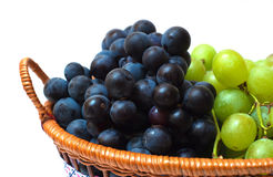 Grape and plums in the basket isolated Royalty Free Stock Images