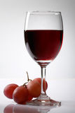 Grape and red wine. On white background Royalty Free Stock Photo