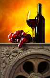 Grape and red wine. On a old marble table Stock Photos