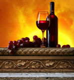 Grape and red wine. On old stone table Royalty Free Stock Image