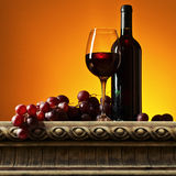 Grape and red wine. On a old stone table Royalty Free Stock Image