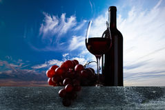 Grape and red wine. On a wooden table Royalty Free Stock Photo