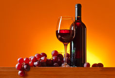 Grape and red wine. On a yellow background Royalty Free Stock Images