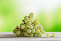 Grape ripe on a wooden table Stock Images