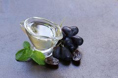 Grape seed oil. In a glass sauce vessel royalty free stock images