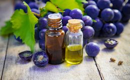 Grape seed oil in a small jar. Selective focus. Nature royalty free stock image