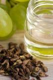 Grape seed oil stock photo