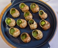 Grape snails baked with butter Royalty Free Stock Photo