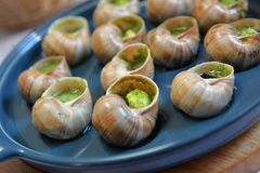 Grape snails baked with butter Royalty Free Stock Images