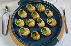 Grape snails baked with butter Stock Image