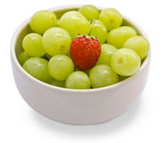 Grape and strawberry. In a white cup stock image