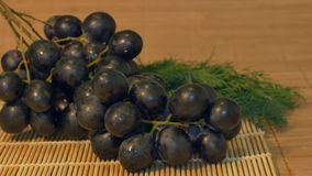 Grape on the Table. Sliding to fresh grape in the kitchen on the table stock footage