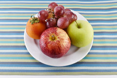 Grape, tomato, apple and yellow measuring tape concept for healt Royalty Free Stock Photo