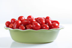 Grape tomatoes in a bowl on white Stock Image