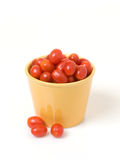 Grape Tomatoes in Gold Pot Royalty Free Stock Photo