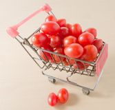 Grape Tomatoes on A Small Shopping Cart Stock Photos