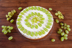Grape torte with green grapes on cake plate royalty free stock photography