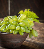 Grape varieties of ladies' fingers in a brown Stock Photography