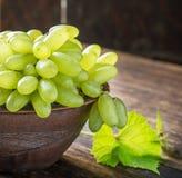 Grape varieties of ladies' fingers in a brown Stock Images