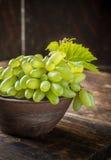 Grape varieties of ladies' fingers in a brown Stock Photo