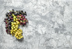 Grape vine concrete stone texture Food background. Grape vine on concrete stone texture. Food background. Red and green grape stock image