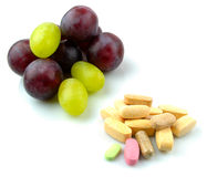Grape and vitamins Royalty Free Stock Photography
