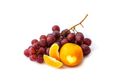 Grape on the white background. Fresh berry and mandarine Stock Images