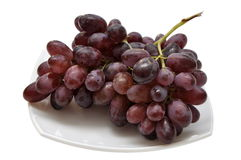 Grape on a white plate Royalty Free Stock Photography