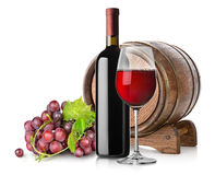 Grape and wine. Grape, wine and a wooden barrel  on white Royalty Free Stock Photo