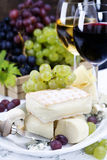 Grape, wine and cheese. Grape and cheese with a bottle and glasses of red and white wine Stock Photo
