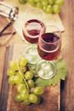 Grape with wine. Green grape with red wine,cork on wooden background Royalty Free Stock Photos