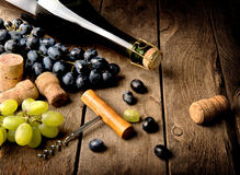Grape and wine on table Stock Images