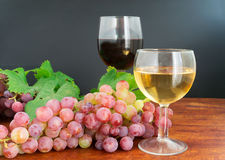 Grape and wine on wood Stock Images