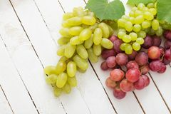 Grape on wooden background royalty free stock images