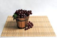 Grape in Wooden Basket Stock Photos