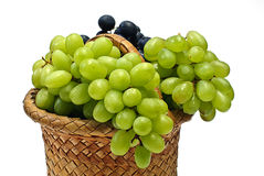 Grape in wooden basket Royalty Free Stock Image
