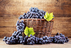 Grape in wooden basket Royalty Free Stock Photo