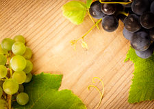 Grape on wooden table Stock Images