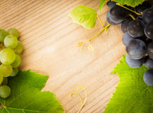 Grape on wooden table Royalty Free Stock Photo