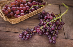 Grape on wooden table Royalty Free Stock Photos