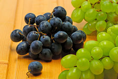 Grape on wooden table. Fresh grape on  wooden table Royalty Free Stock Photography