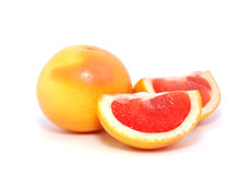 Grapefruit. The whole and sliced grapefruit on a white background Stock Photos
