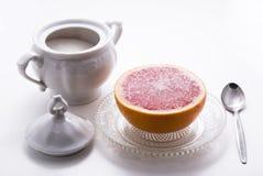 Grapefruit. Breakfast dessert with sugar and grapefruit Stock Photos