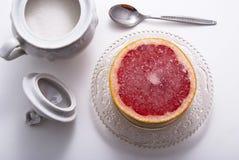 Grapefruit. Breakfast dessert with sugar and grapefruit Royalty Free Stock Image