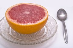 Grapefruit. Breakfast dessert with sugar and grapefruit Stock Photography