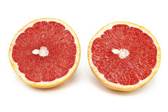 Grapefruit. Two round slices of grapefruit on a white background Stock Photos