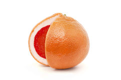 Grapefruit. Red grapefruit with the cut-out segment  isolated on wight background Royalty Free Stock Photo