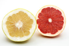 Grapefruit. Sliced pieces of grapefruit and green fruit isolated on white Stock Photography